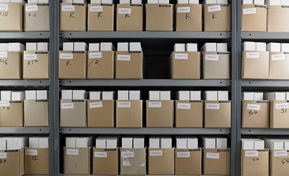 Archive boxes stacked on shelving