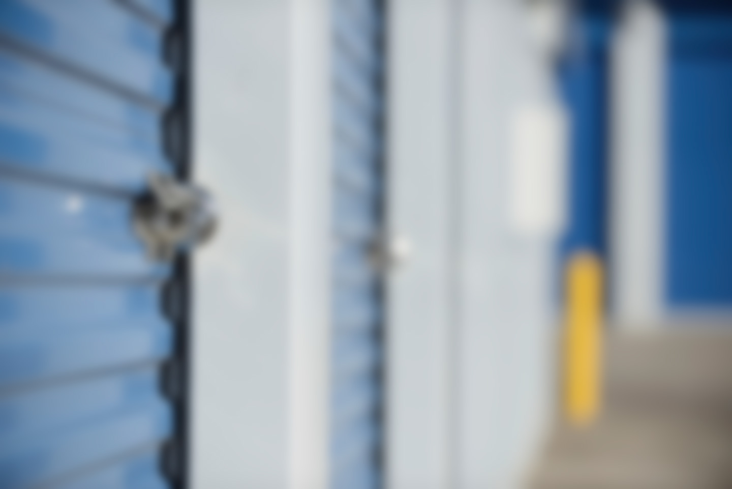 Blurred image of a locked storage unit door